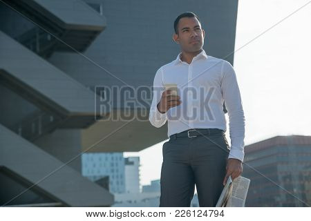 Contemplative Handsome Male Manager Walking In City And Thinking About Message. Serious Pensive Youn