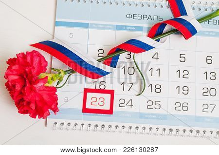 23 February Card. Red Carnation, Russian Flag And Calendar With Framed Date 23 February. Defender Of