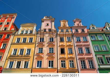Colorful houses on Market square, Wroclaw, Poland. Townhouses in medieval market square, rynek. City centre, ancient homes. Tenement houses, popular landmark. Famous Wroclaw Old Town, Lower Silesia poster