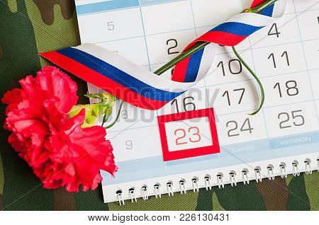 23 February Festive Card. Red Carnation, Russian Flag And Calendar With Framed Date 23 February On T