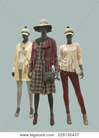 Three Female Mannequins Dressed In Fashionable Clothes, Isolated. No Brand Names Or Copyright Object