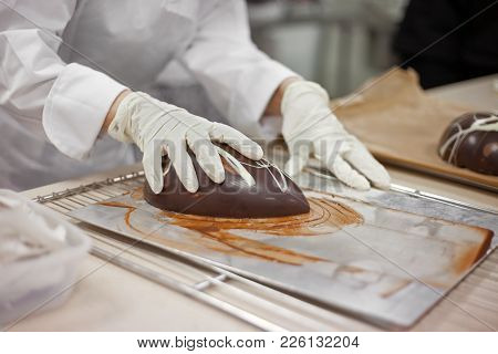 Making Chocolate. Making Chocolate Easter Eggs. Chocolate Factory.
