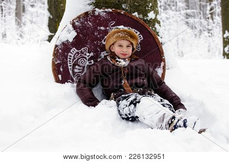Portrait Of A Young Viking. Viking Warrior With Chain Mail Leather Spear Walking In Winter Woods Bef