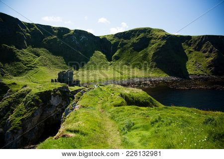 North Ireland, Kinbane Caste Ruin, Green Grassy Surround, Blue Sea And Ocean, Landscape