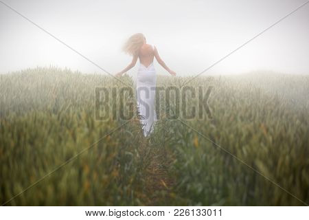 Beautiful Slim Blonde Woman Plays In White Dress, Fogy Meadow, Outdoor