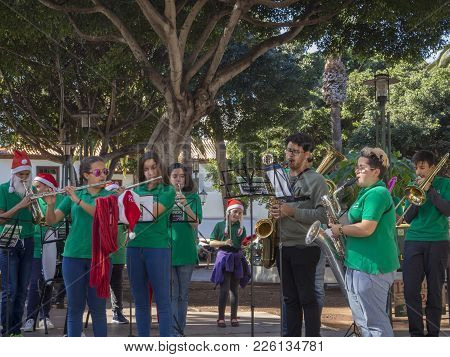 Spain, Canary Islands, Tenerife, Puerto De La Cruz, December 23, 2017, Group Of Young People Brass B