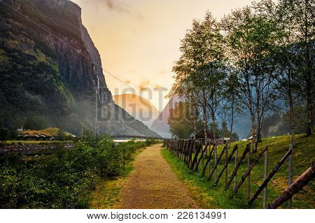 Beautiful Views Of The Sunrise Over The Fjord And Mountains From The Bridge In The Norwegian Village