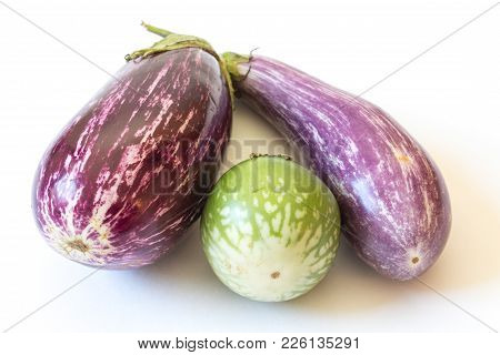 Blossom End View Of Thai And Dominican Eggplants Solanum Melongena Food Ingredients, Isolated On Whi