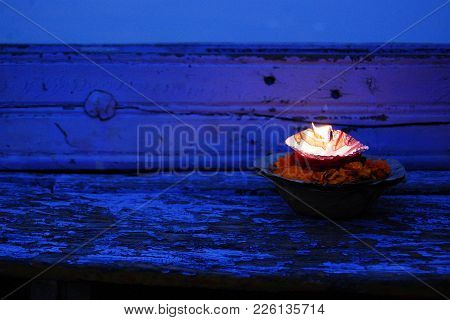 Burning Candle And Flowers Background. Close-up. Hinduism. Offering Candle To Ganges River. Hinduism