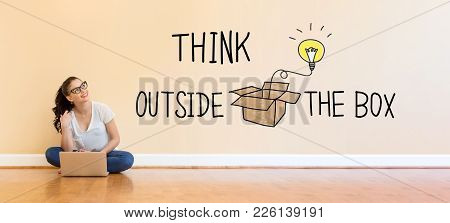 Think Outside The Box Text With Young Woman Using A Laptop Computer On Floor