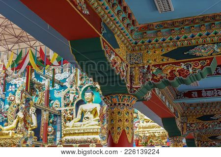 Coorg, India - October 29, 2013: Combination Shot Of The Buddha Golden Statue And Columns Inside Pad