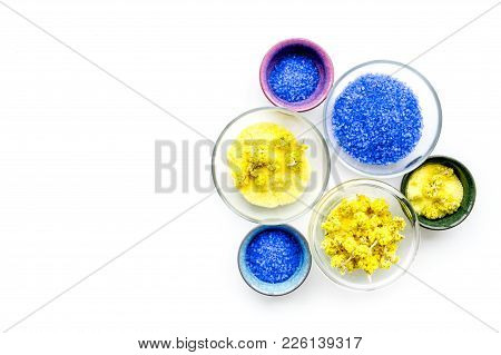 Colorful Spa Salt. Yellow Spa Salt With Delicate Spring Flowers And Violet Lavender Spa Salt On Whit