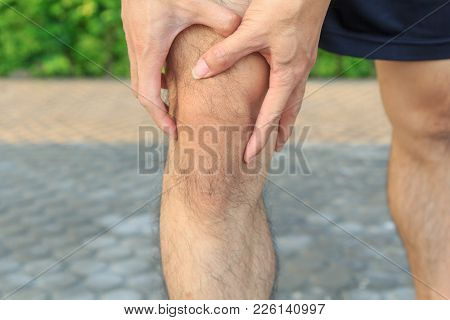 The Man Has Pain At Knee And Touch His Knee