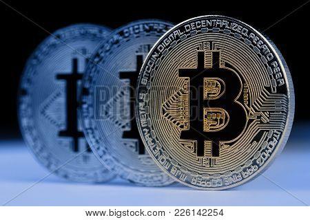 Horizontal Front View Closeup Of Bitcoin Golden Metallic Coins On Dark Background