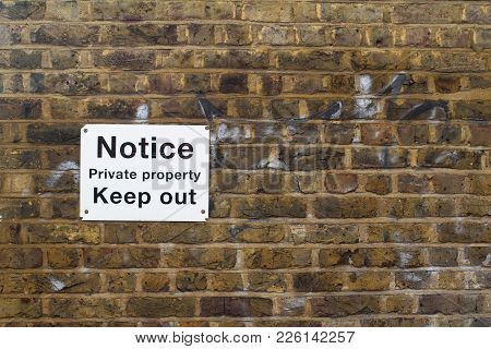 Private Property White Sign On Brick Wall