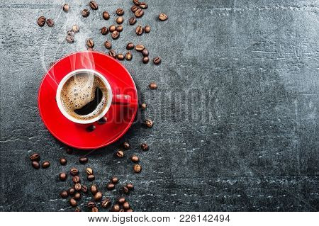 Coffee Cup Background With Coffee Beans Top View.