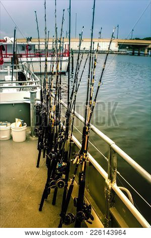 Rods Are On The Deck Of A Boat, All Ready For Sea Fishing. Copy Paste