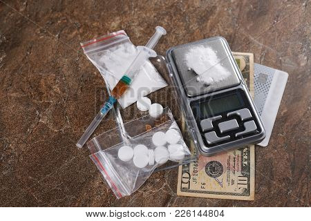 Narcotic Syringe And Cooked Heroin, Cocaine On The Scales And Pills. Copy Paste