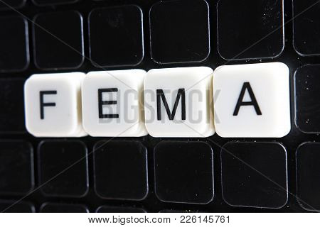 Fema Text Word Title Caption Label Cover Backdrop Background. Alphabet Letter Toy Blocks On Black Re
