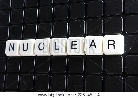 Nuclear Text Word Title Caption Label Cover Backdrop Background. Alphabet Letter Toy Blocks On Black