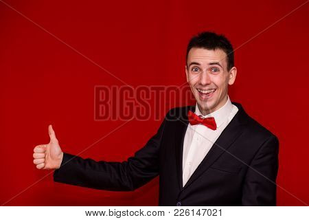 Half Body Photo Of Young Stylish Man In Suit Giving Thumb Up. Happy Man With Arm Bent At The Elbow A