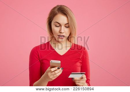 Indoor Shot Of Puzzled Female Doesn`t Recieve Salary, Checks Bank Account Via Online Application, Us