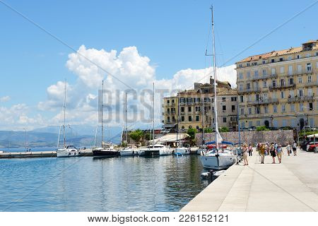 Kerkyra, Greees - May 17: The Tourists Are On Seafront And Sail Yachts On May 17, 2016 In Kerkyra, G