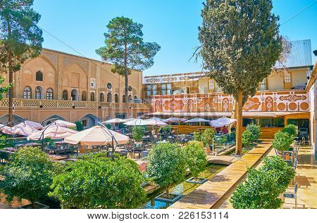 Isfahan, Iran - October 20,2017: The Courtyard Of Historical Mansion With Shady Garden Is Served As