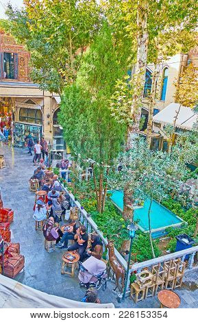 Isfahan, Iran - October 20, 2017: The Small Food Court With Garden And Fountain Is Located In Yard O