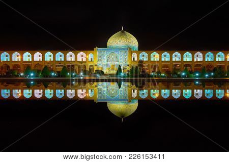 The Architectural Ensemble Of Sheikh Lotfollah Mosque Is Reflected In Mirror Of The Pond In The Midd