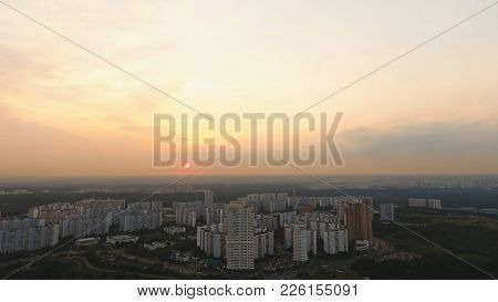 Aerial View Moscow Skyline Of Big City Full Of Skyscrapers At Sunset. Urban Landscape Of Large Citie