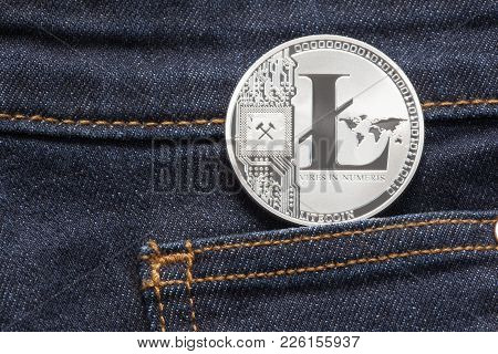 Silver Litecoin Physical Coin In Dark Blue Denim Pocket.