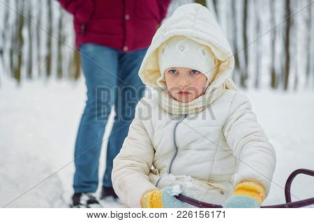 Little Sad Girl On A Winter Day. Offended Child People Insult Children