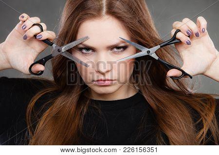 Professional Elegant Female Barber With Scissors.