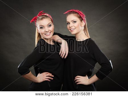 Love And Affection In Family. Blonde Gorgeous Sisters Stylized On Retro Pin Up Vintage Style. Two Gi