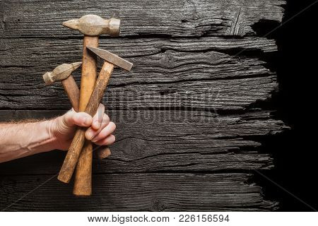 Bouquet Of Hummer Tools As Gift Against Wooden Background. Industrial Concept.