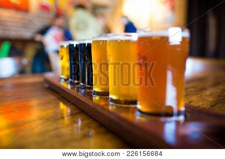 A Variety Set Of Craft Beers Light And Dark On The Table