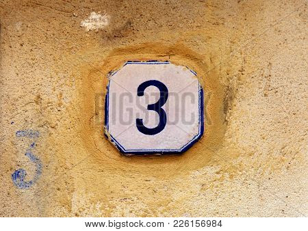 Weathered House Number 3 (three) On Old Yellow Stone Wall