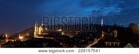 Lesser Quarter After Dark. With Petrin Hill With Lookout Tower And St Nicholas Cathedral Dome And Cl