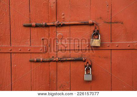 The Padlock Locking The Wooden Door, Old Metal Lock On A Painting Door