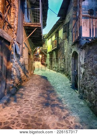 Old Houses In Kakopetria Village, Cyprus In Twilight. Kakopetria, Famous Touristic Village In The Tr