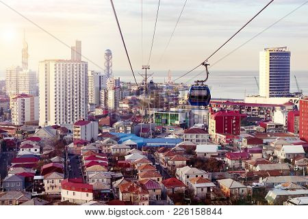 Aerial Cableway Above City Roofs Of Batumi, Georgia. Urban Landscape With High-rise And Ordinary Sin
