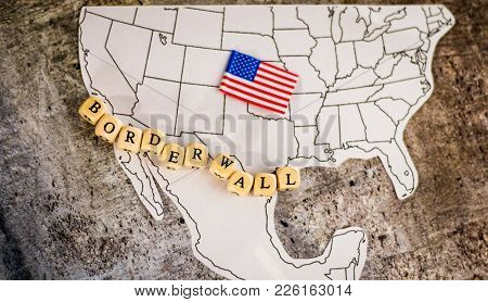 Border Wall Business Concept With Border Wall Letter Blocks Placed Over The Us And Mexico Border