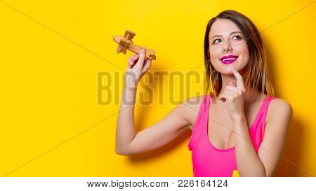 Girl Holding Wooden Toy Airplane