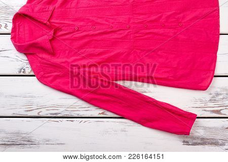Female Red Shirt On Wooden Background. Women Classic Long Sleeve Blouse On White Wooden Table, Top V