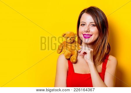 Girl In Red Dress With Teddy Bear Toy On Shoulder