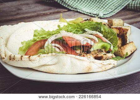 Chicken Pita Sandwich Plate On Wooden Table