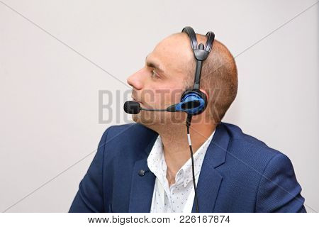 Man In Blue Suit With Voice Technology Headset