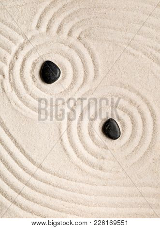 Zen Sand And Stone Garden With Raked Lines, Curves And Circles. Simplicity, Concentration Or Calmnes