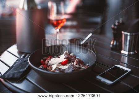 True Tilt-shift Shooting Of Table In Street Restaurant Served With Clay Plate With Delicious Meat Sa